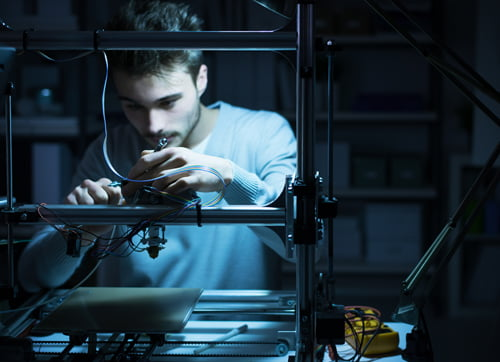 Young engineer working on a 3D printer